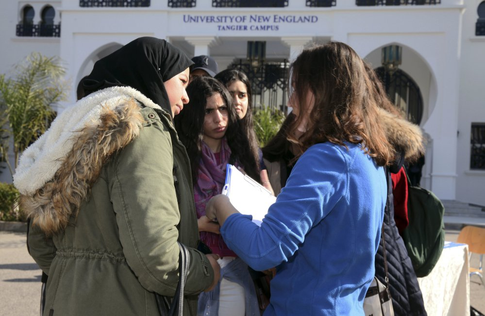 Political science major and resident assistant Clancy Phillips, right, speaks to prospective students at an open house at the University of New England's satellite campus in the Moroccan coastal city of Tangier. In response to concerns about anti-immigrant sentiment, some U.S. colleges are making new efforts to help international students feel welcome and reassure them of their safety.
