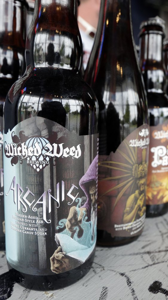 Brawley's Beverage in Charlotte, N.C., was selling off its Wicked Weed beer, above, on Thursday and ending sales of the brand to protest the purchase of the craft brewer by beer behemoth Anheuser-Busch Inbev, maker of Budweiser.