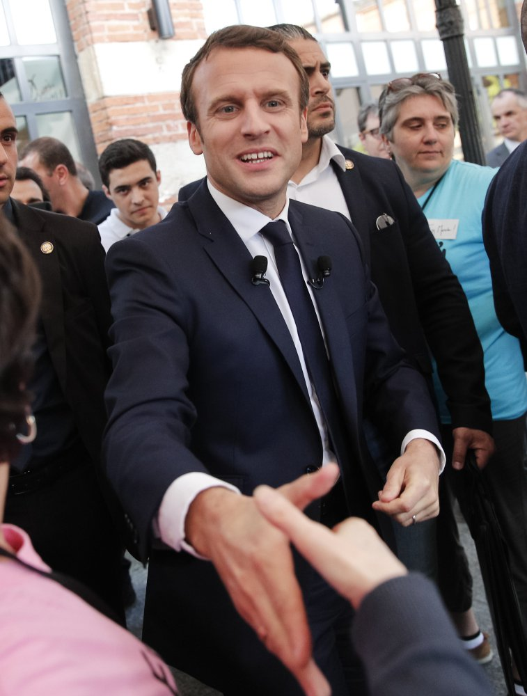 "Independent presidential candidate Emmanuel Macron shakes hands with supporters during a campaign rally Thursday in southern France. His campaign said Friday that it was targeted in a ""massive and coordinated"" hacking attack that led to the leak of campaign emails and financial documents."