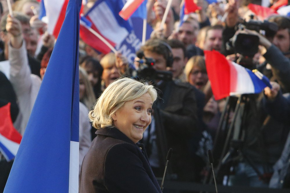 "French far-right presidential candidate Marine Le Pen addresses people Thursday in northern France. She claimed an ""ideological victory"" for her populist, anti-immigrant campaign."