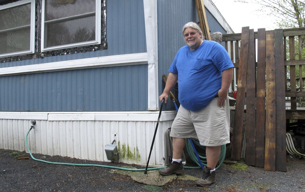 """Todd Alexander, a disabled painting contractor from Milton, Vt., says the Low Income Home Energy Assistance Program has helped him for years. """"This helps low-income people that are working. This isn't just about people, as they say ... doing nothing on welfare,"""" he said."""