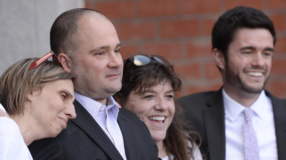Justice Joyce Wheeler has ordered a radio station and a TV station to produce outtakes of interviews with the prosecutor in the case of  Anthony Sanborn Jr., second from left, as he challenges his conviction in the 1989 murder of Jessica L. Briggs. Sanborn's wife, Michelle, left, his attorney Amy Fairfield and paralegal Keegan Fairfield accompanied him April 13 as he was freed on bail set by Wheeler.