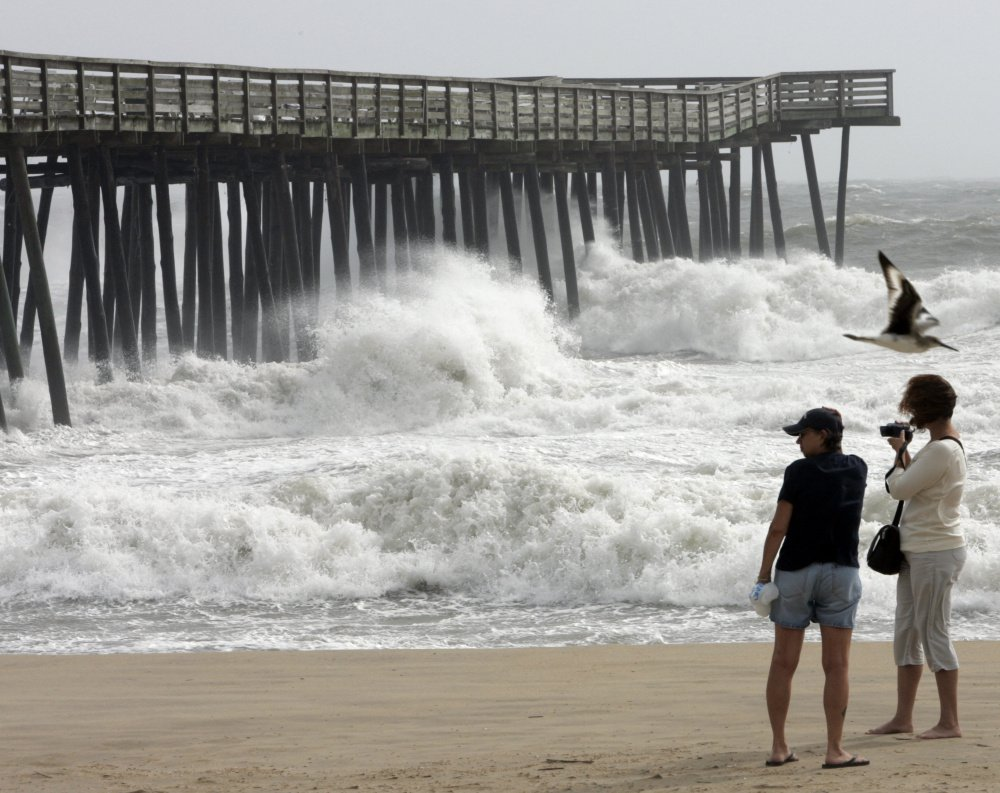 Beachgoers enjoy the view at the Virginia Beach fishing pier. Beach communities along the East Coast have been leery of plans for oil exploration.