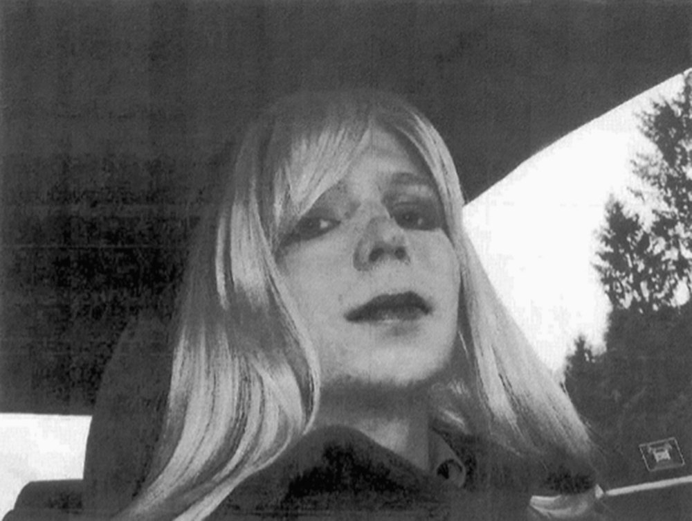 In this undated file photo provided by the U.S. Army, Pfc. Chelsea Manning poses for a photo wearing a wig and lipstick. Manning, the transgender soldier convicted in 2013 of illegally disclosing classified government information, was released from prison Wednesday.