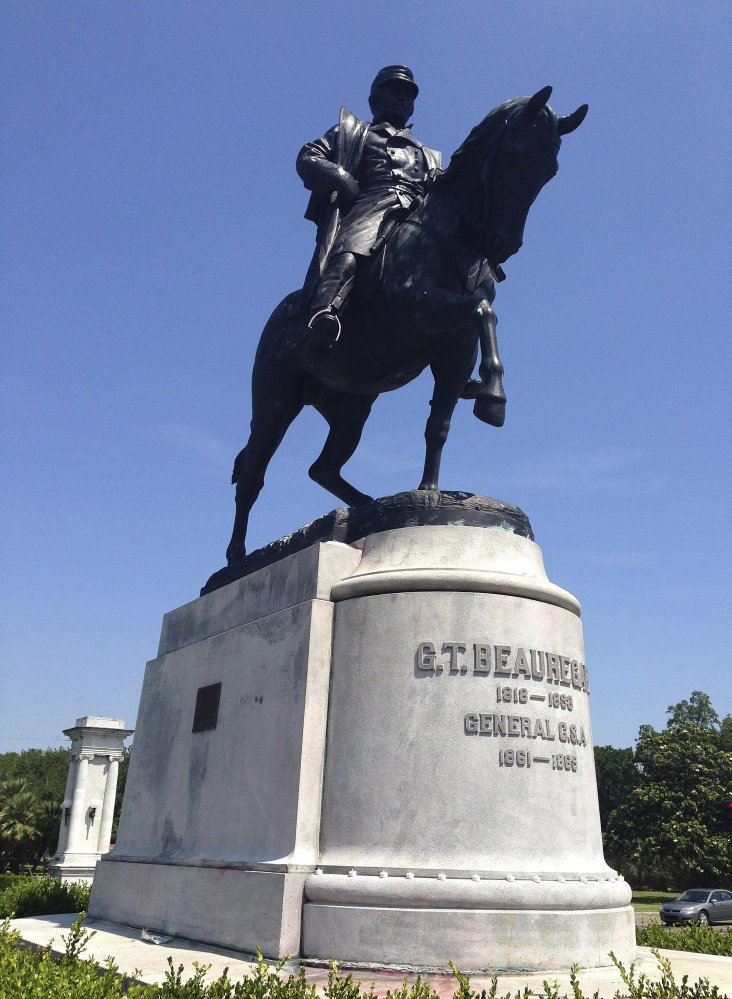 Confederate Gen. P.G.T. Beauregard's statue in New Orleans came down Wednesday under the cover of darkness, the third of four statues the city is removing.
