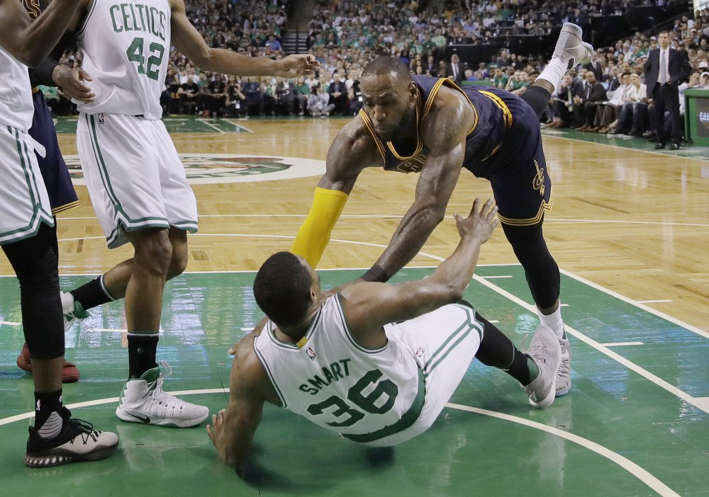 Cleveland's LeBron James falls to the floor with Boston's Marcus Smart in the second quarter of Game 1 of the Eastern Conference finals Wednesday night in Boston.