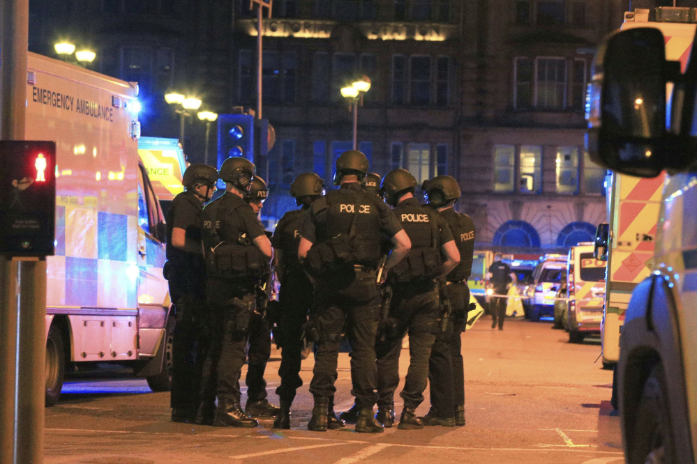 Armed police gather at Manchester Arena after reports of an explosion at the venue during an Ariana Grande concert.