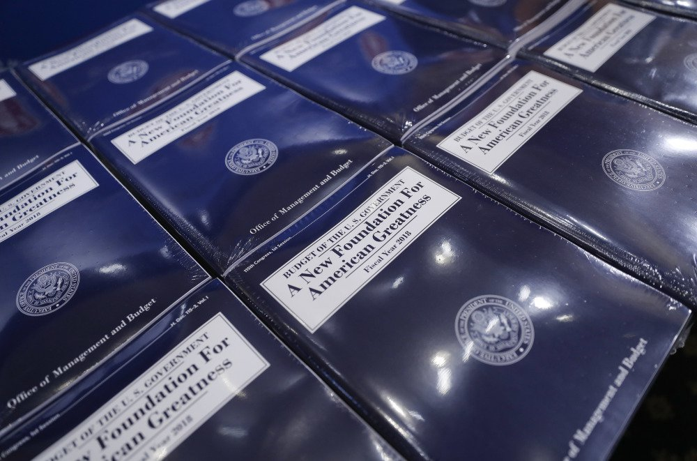 Copies of President Trump's fiscal 2018 federal budget are laid out ready for distribution on Capitol Hill in Washington.