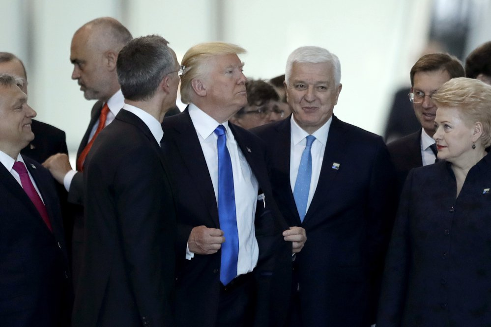 Montenegro Prime Minister Dusko Markovic, center right, appeared to be pushed aside by President Trump during a NATO summit of heads of state and government in Brussels on Thursday.