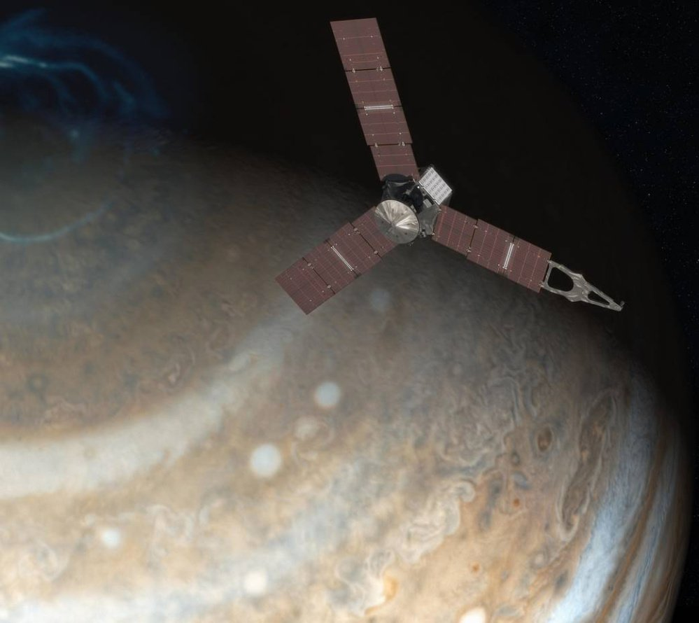 An artist's rendering, left, depicts NASA's Juno spacecraft above Jupiter's north pole. Above, this image made available by NASA on Thursday from data captured by the Juno spacecraft shows Jupiter's south pole. The oval features are cyclones, up to 600 miles in diameter. NASA via Reuters/Associated Press