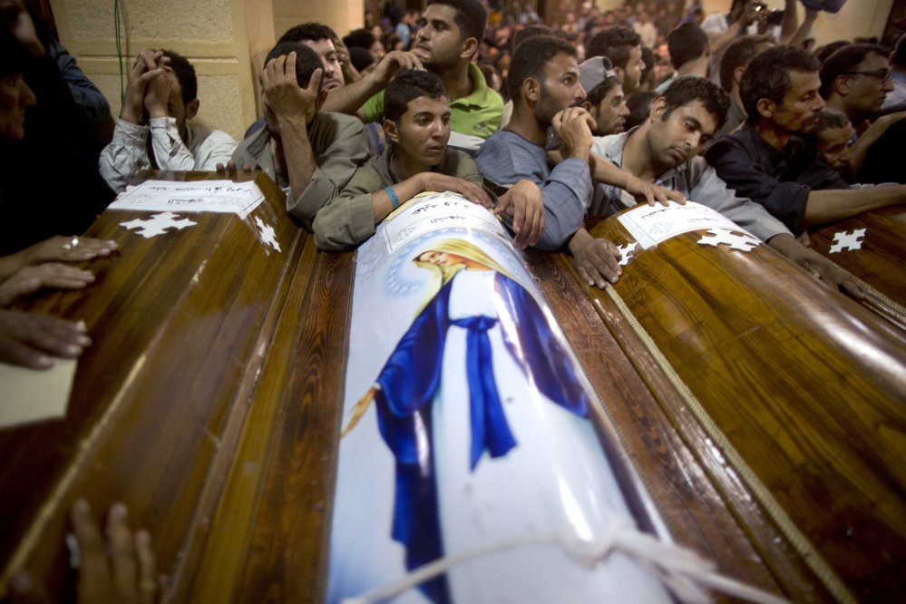 Relatives of Coptic Christians who were killed during a bus attack surround their coffins during their funeral service at Abu Garnous Cathedral in Minya, Egypt, on Friday.