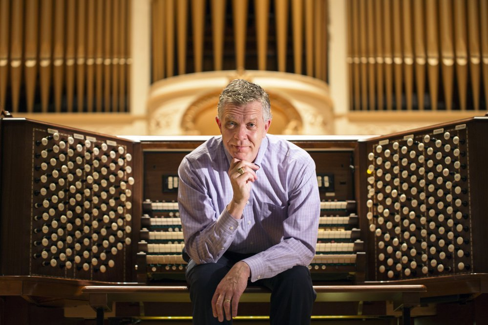 Municipal organist Ray Cornils at the Kotzschmar Organ at Merrill Auditorium. Cornils plans to retire at the end of this year.