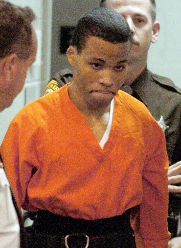 Lee Boyd Malvo, a notorious sniper, enters a court 2004.