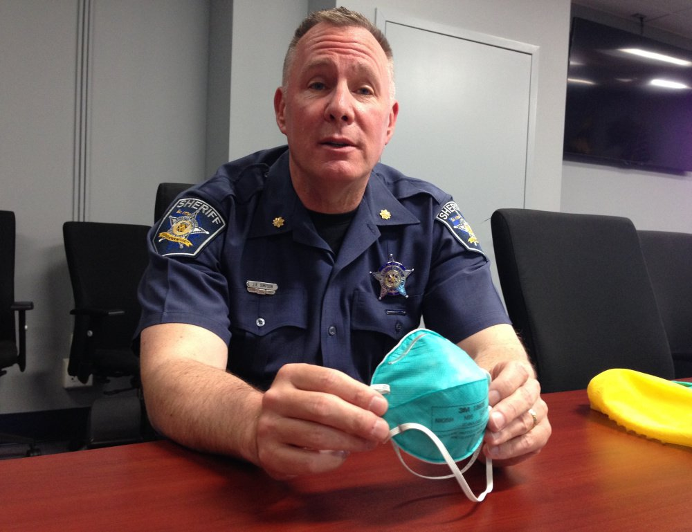 Harford County (Md.) Maj. John R. Simpson displays elements of a protective suit that the sheriff's office is now providing to deputies sent to crime scenes involving heroin and synthetic opioids, some of which are powerful enough to tranquilize elephants.