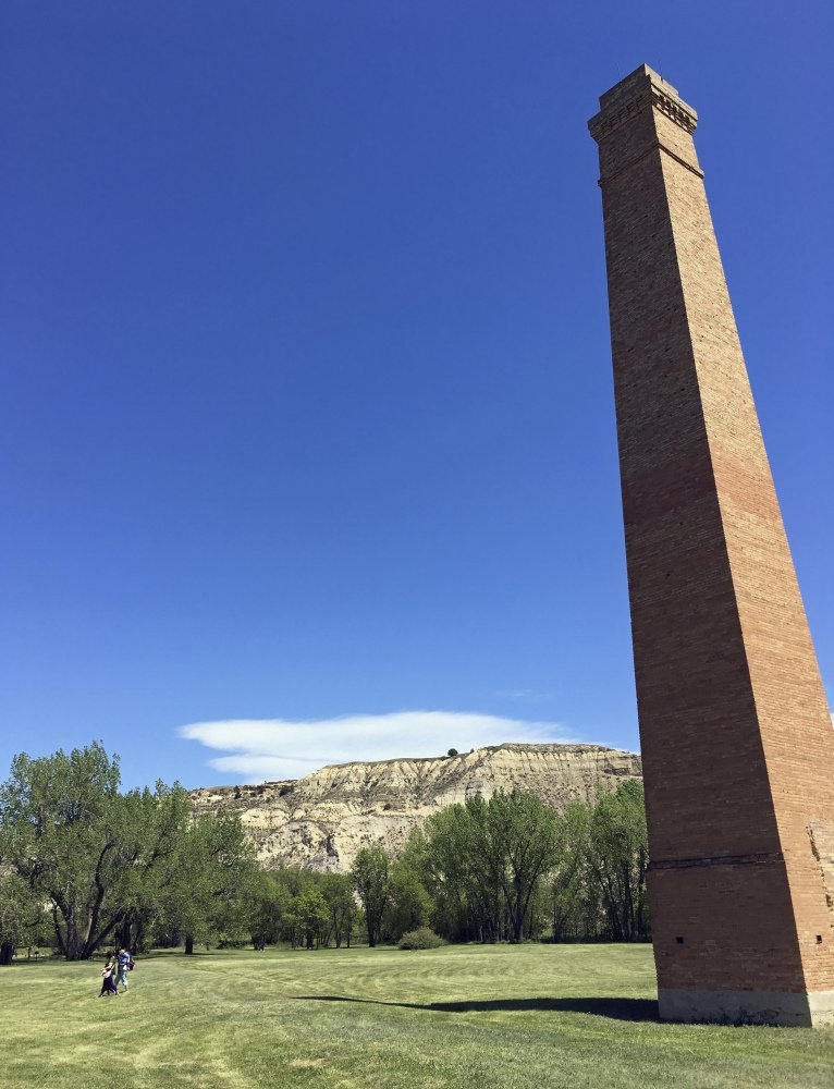"A smokestack from an Old West-era meatpacking plant is shown in Theodore Roosevelt National Park in western North Dakota, where Meridian Energy Group has set off alarms by proposing to build what it describes as ""the cleanest refinery on the planet."""