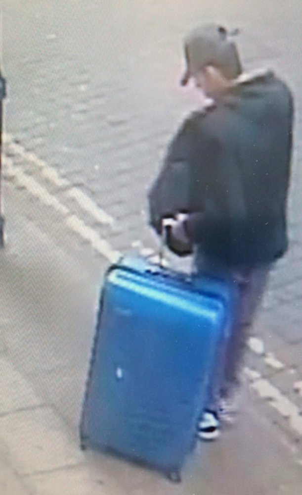 Suicide bomber Salman Abedi pulls a distinctive blue suitcase in a picture taken in the days before the blast at an Ariana Grande concert in Manchester, England.