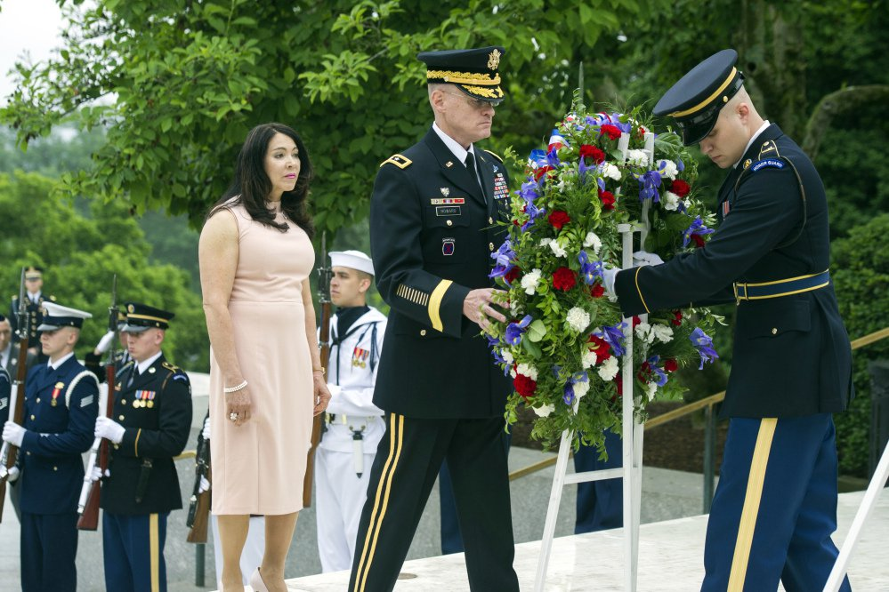 Army Maj. Gen. Michael Howard, right, and Karen Durham-Aquilera of Army National Cemeteries lay a wreath at the grave of former President John F. Kennedy in Arlington National Cemetery on Monday, the 100th anniversary of his birth.