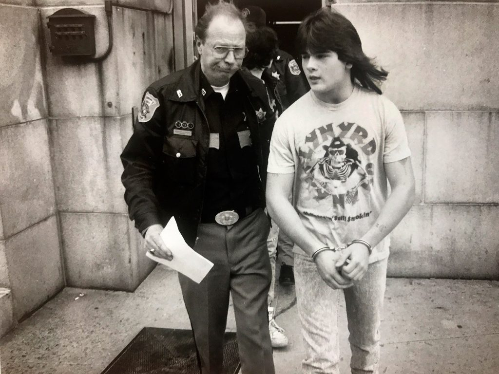 Anthony Sanborn is led from the Cumberland County Courthouse on April 19, 1990, while waiting to be arraigned in the murder of Jessica Briggs.