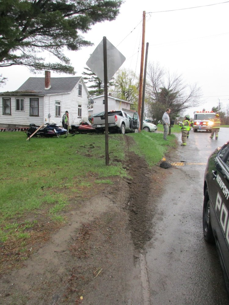 Electrical service was ripped off a house in Newport on Tuesday morning after a pickup truck crashed into a utility pole.