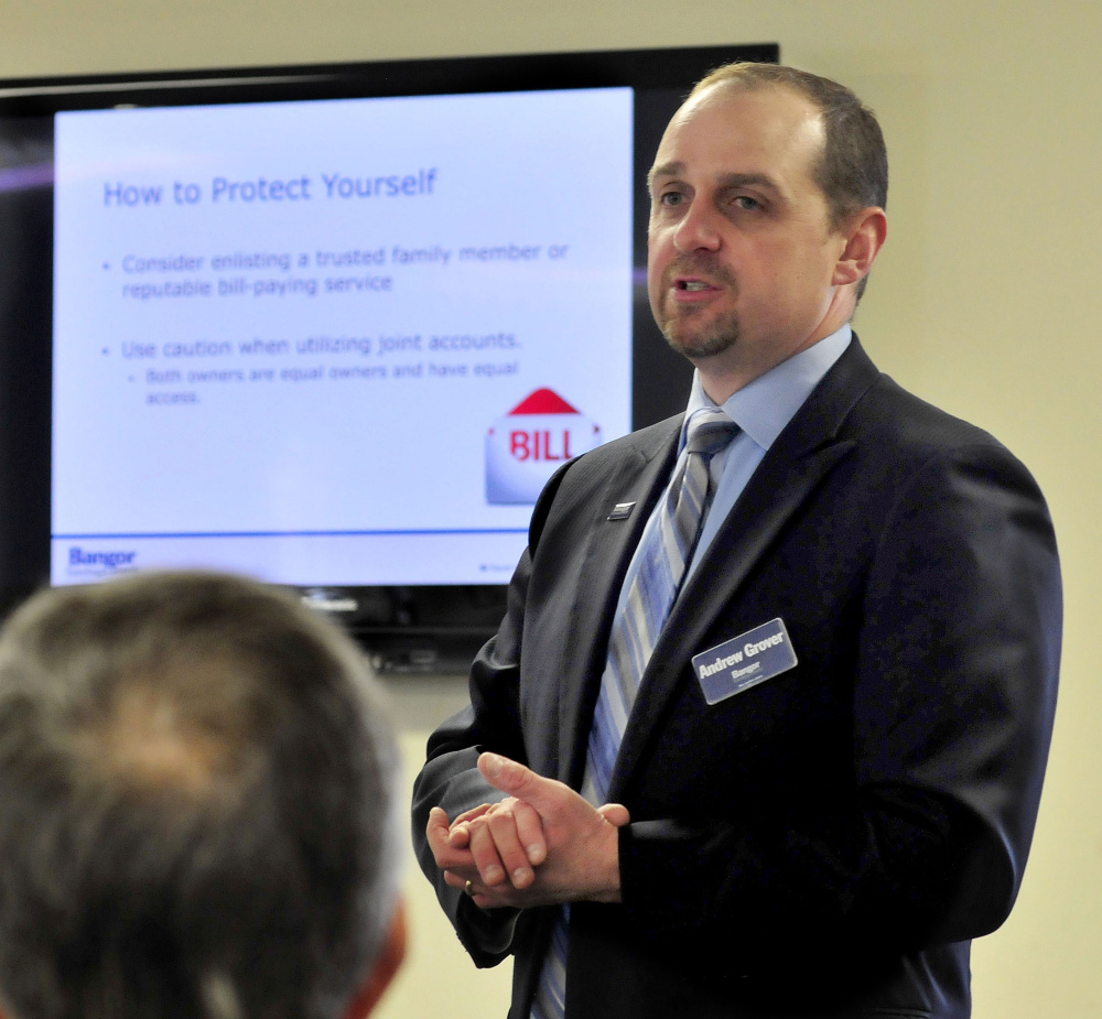 Andrew Grover, a risk officer at Bangor Savings Bank, offers advice on how to protect one's identity and money Tuesday during a seminar at China Baptist Church in China.
