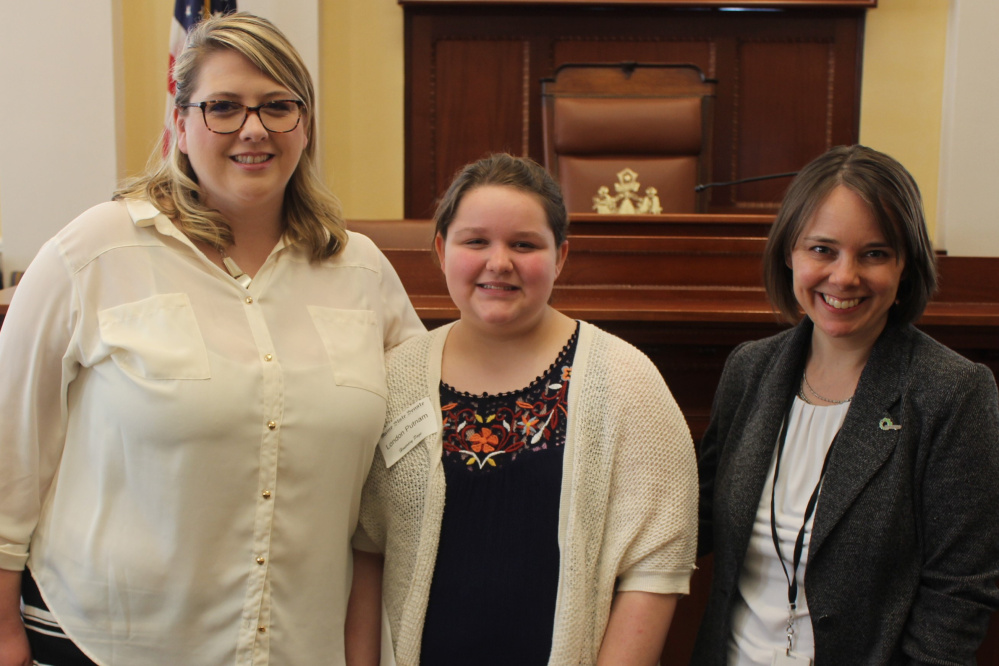 Maranacook Community Middle School student London Putnam served as an honorary page April 11 in the Maine Senate. From left are Katie Putnam, London and Bellows.