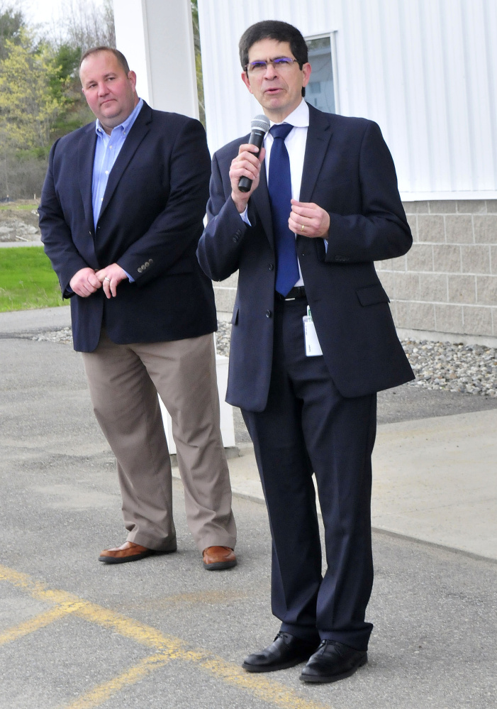 Milson Gondim, right, Elanco vice president of global vaccine manufacturing, speaks to employees Wednesday during the opening of the company's new autogenous poultry vaccine facility in Winslow. At left is sales manager Tim Hopson.