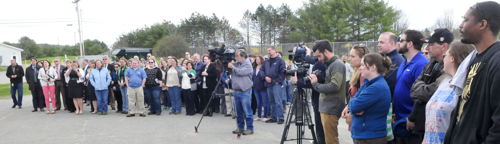 Elanco employees assemble for the opening of the company's new autogenous poultry vaccine facility Wednesday in Winslow.