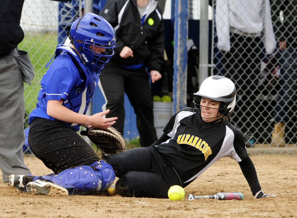 Erskine catcher Taylor McLaggan, left, looses the ball as Maranacook's Faith Jacques scores Wednesday in South China.
