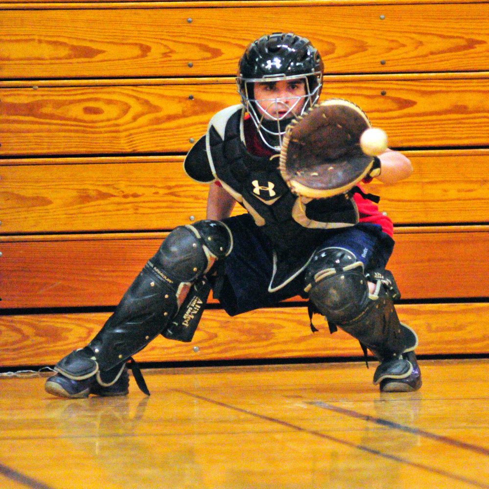 Erskine catcher Nick Turcotte catches a pitch during a March preseason practice in South China.