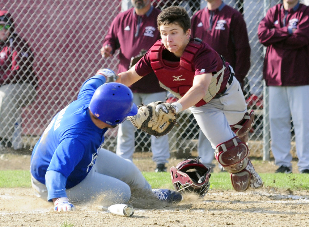 Richmond catcher Tristan Shea scrambles to tag Valley's Brandon Thomas but isn't in time Thursday in Richmond.