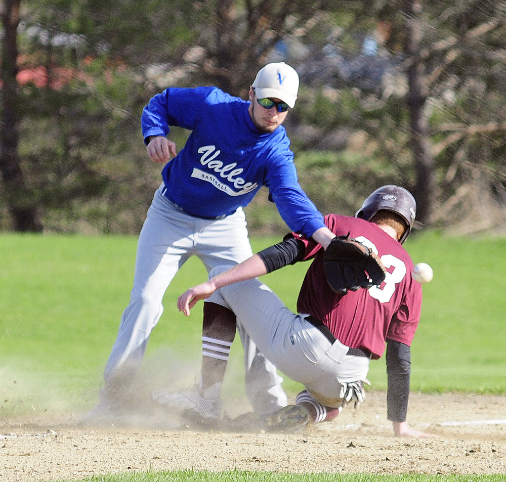 Valley third baseman Donovan Beane looses the ball as Richmond's Dan Stewart slides into third during a game Thursday in Richmond. Stewart went onto score on the play.