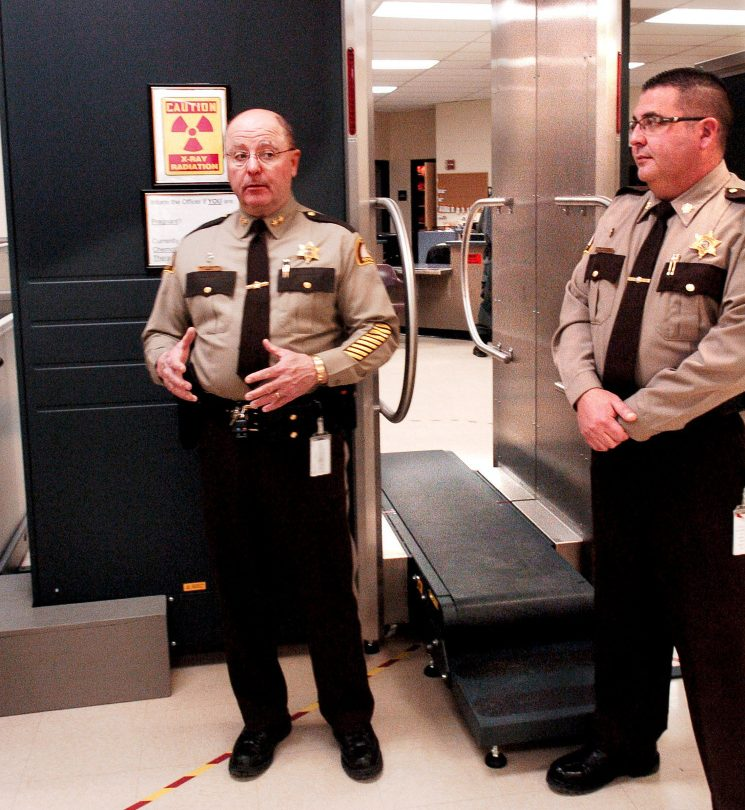 Somerset County Sheriff Dale Lancaster, left, and Somerset Jail Administrator Cory Swope discuss a new state-of-the-art body scanner Jan. 19 at the intake department at the East Madison jail. The scanner detected drugs on an inmate, and jail officials believe not all of it was detected. They are investigating the incident and charges are expected.