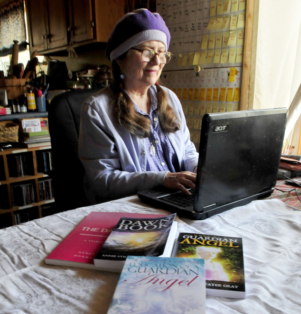 Author and mystic Annie Stillwater Gray works on a manuscript Thursday at her home in Solon.