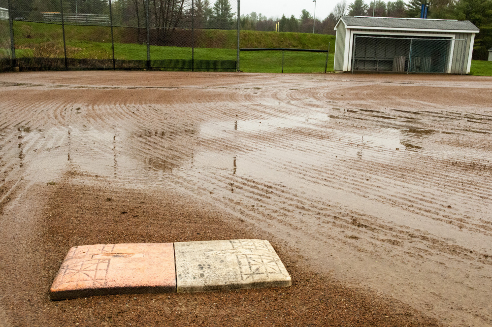 Standing water is shown on the softball field at Maranacook Community School in Readfield.