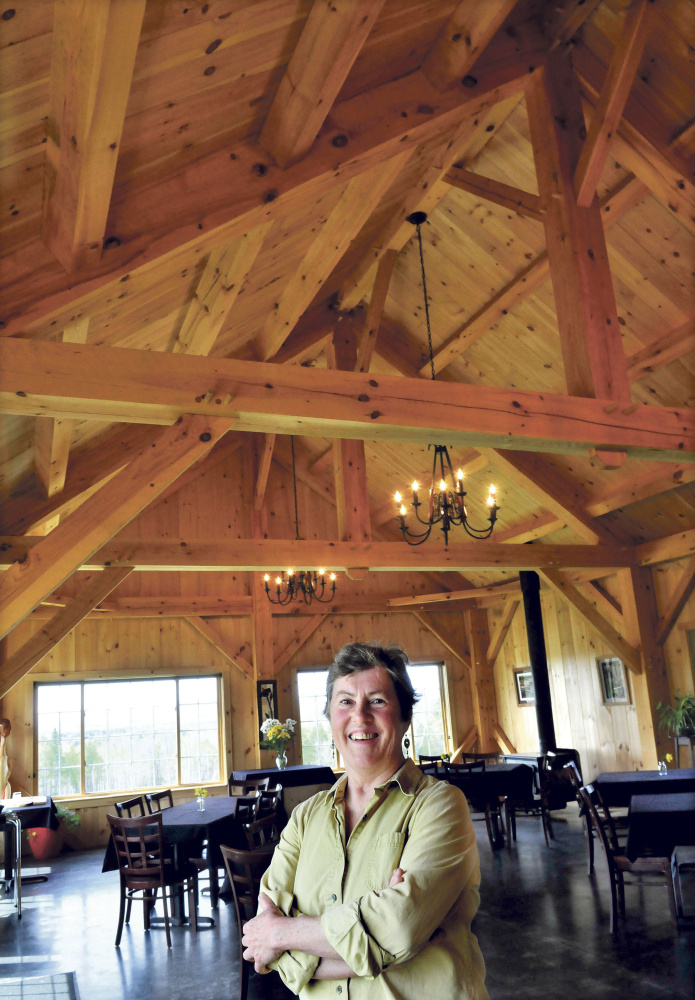 Mary Burr speaks Thursday inside her timber framed restaurant 122 Corson, the same as its address in Mercer. The restaurant features locally grown and raised meats and vegetables complete with fancy desserts and alcoholic beverages in a country setting.