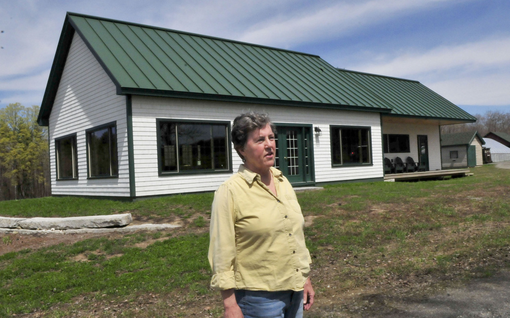 Mary Burr speaks Thursday about her restaurant, 122 Corson, the same as its address in Mercer. The restaurant features locally grown and raised meats and vegetables complete with fancy desserts and alcoholic beverages in a country setting.