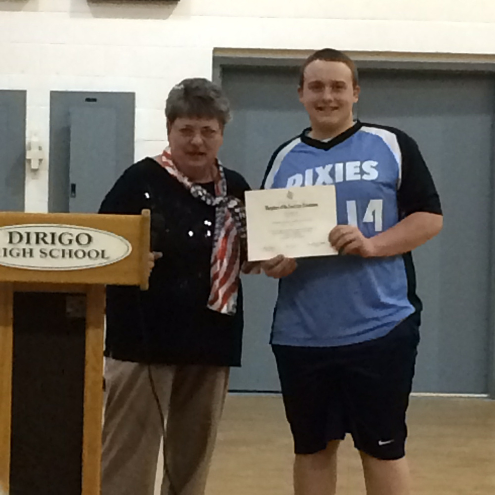 Mason Corriveau, right, a Dirigo High School senior, recently was presented a 2017 Good Citizen Award by Charlotte Collins, a member of The Colonial Daughters Chapter Daughters of the American Revolution of Farmington, during an assembly.