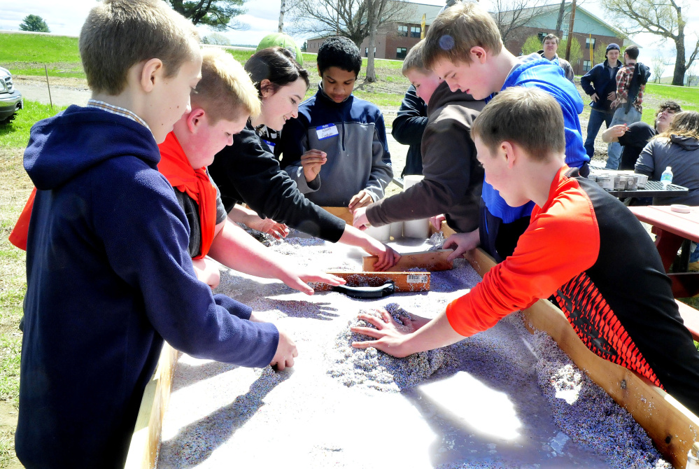 Skowhegan Middle School students explore a water erosion demonstration station at the Marti Stevens Learning Center in Skowhegan during a forest field day on Wednesday.