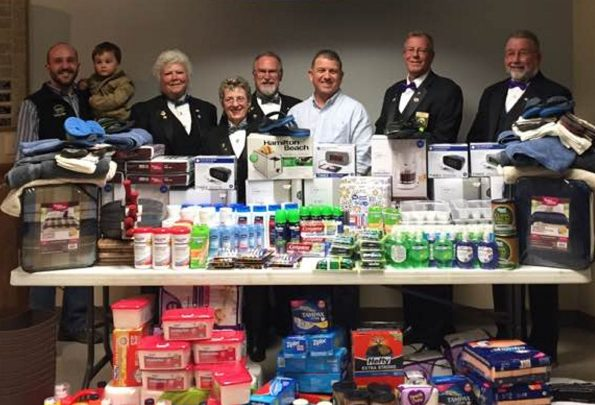 Waterville Elks Lodge 905 recently assisted the Mid Maine Homeless Shelter with a large donation of goods to help with the day-to-day operations of the shelter. Officers, from left, are Nick Champagne, holding Owen Champagne; Sandi Anderson, Felicia Gaulin, Dave Hammond, Board of Directors member Brian Watson,  Don Young and Dave Anderson.