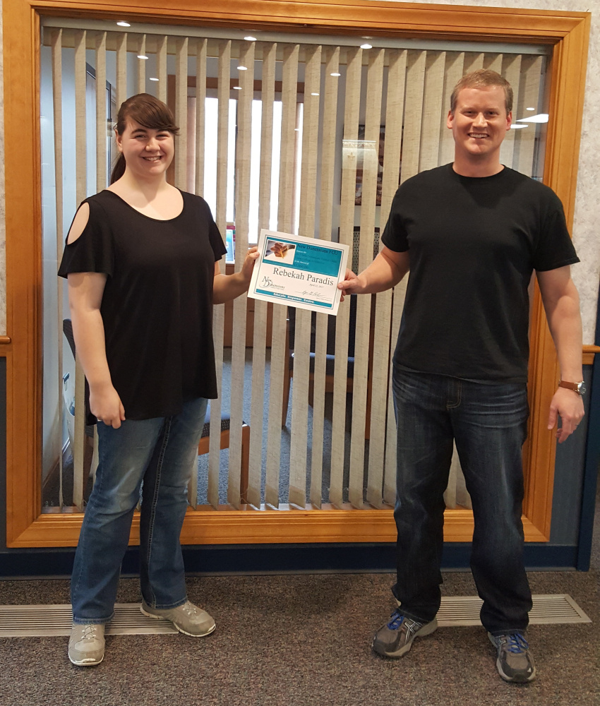 Rebekah Paradis, right, accepts her 2017 New Dimensions Federal Credit Union College Scholarship certificate from Peter Dow.