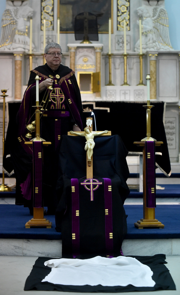 The Rev. Larry Jensen performs Good Friday rituals April 14 at St. Joseph's Maronite Church in Waterville.