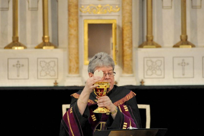 Staff file photo by Michael G. Seamans The Rev. Larry Jensen puts Communion into the Holy Chalice on April 14 during the Signing of the Chalice ritual at St. Joseph's Maronite Church on Appleton Street in Waterville.