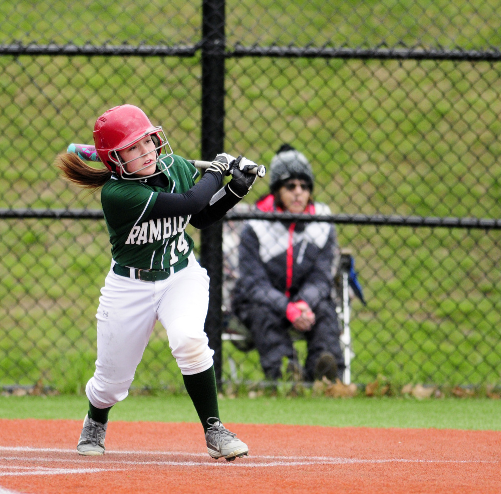 Moriah Hajduk clobbers a two-run triple to tie the score at 2-2 in the third inning Tuesday against Monmouth Academy in a game played at Kents Hill School.