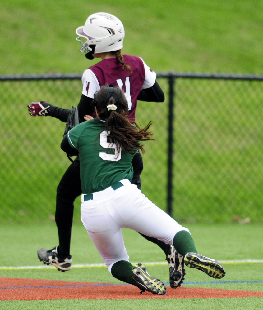 Winthrop third basemen Amber Raymond (9) tags out Monmouth Academy baserunner Emily Kaplan to end the fourth inning during a game Tuesday at Kents Hill School.