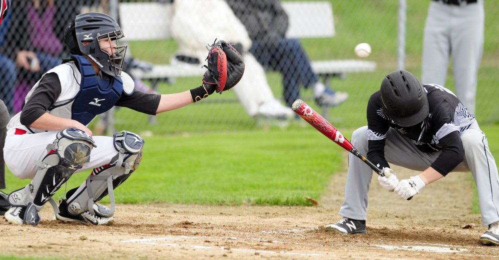 Hall-Dale catcher Akira Warren catches a high inside pitch as a Bridgeway batter ducks during a game on Tuesday at Hall-Dale High School in Farmingdale.