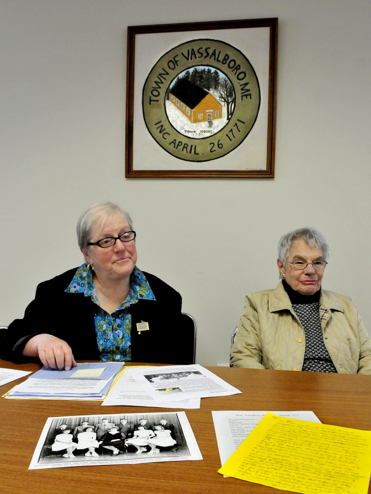 "Vicki Schad, left, and Ester Bernhardt, members of the Vassalboro Historical Society, discuss progress on Thursday on ""The Vassalboro Anthology of Tales,"" a compilation of stories about the town and residents."