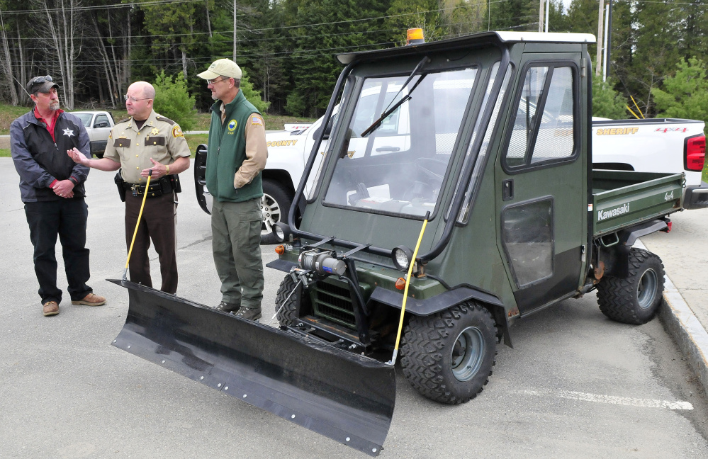 Somerset County Sheriff Dale Lancaster, center, speaks about the donation of the all terrain vehicle to Lake George Regional Park on Tuesday. At left is Sheriff Office Work Crew Supervisor Dave Davis and at right is park ranger Derek Ellis.