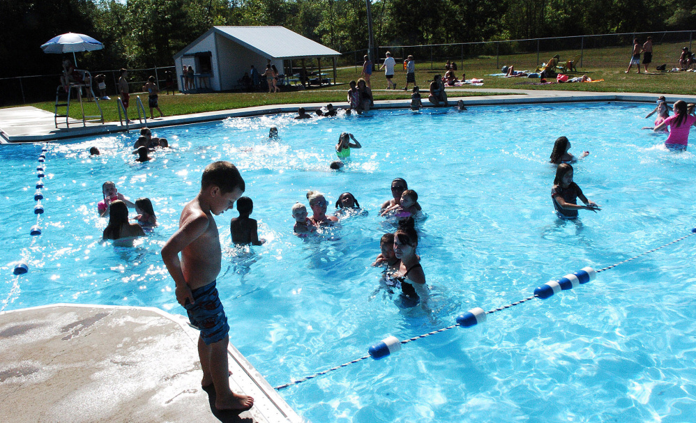 Kids and parents enjoy the Alfond Municipal Pool in Waterville on August 21, 2016. City councilors will consider a hike in pool fees at their meeting Tuesday.