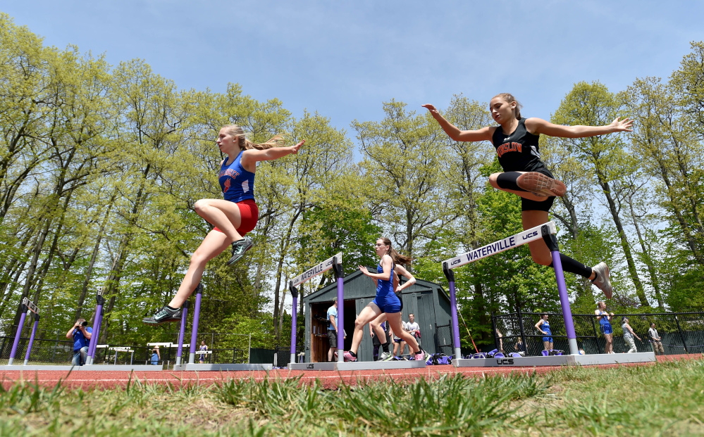 Athletes compete in the 300-meter hurdles during the annual Community Cup last year at Waterville Senior High School.