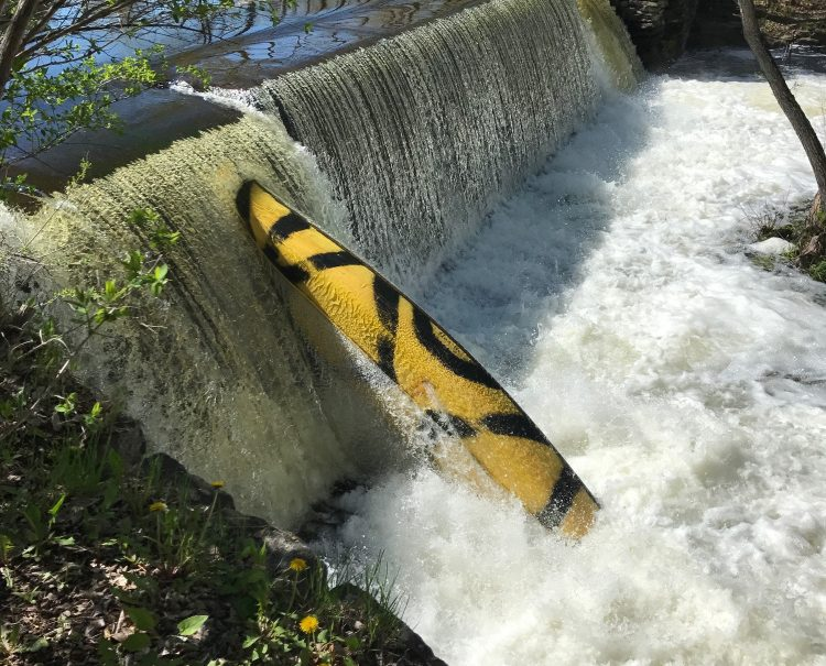 This is the canoe that Maine game wardens believe tipped over in Outlet Stream in Vassalboro Monday night, resulting in the death of 5-year-old William Egold. The canoe was upright against falls on the stream Tuesday morning.